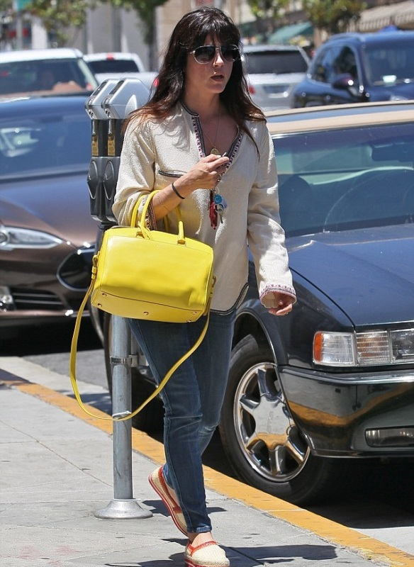 Selma Blair With A Cheery Saint Laurent Tote 5