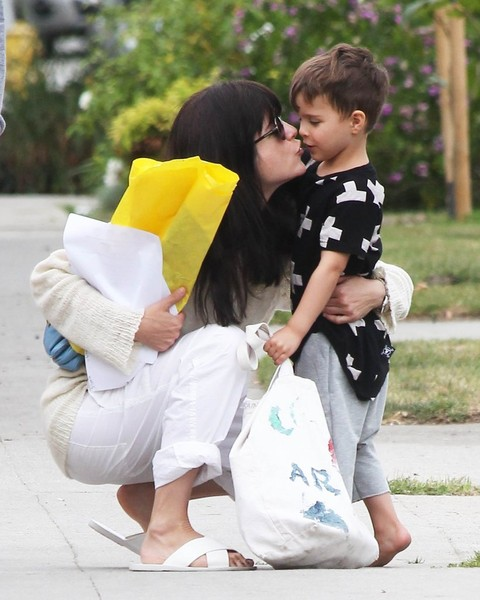 Selma Blair Sneaks A Smooch From Saint