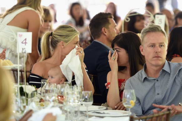 Selma Blair and Ali Larter weep as they listen to the speakers about Batten disease