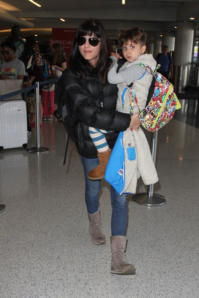Selma Blair Arrives at LAX with son Arthur 7